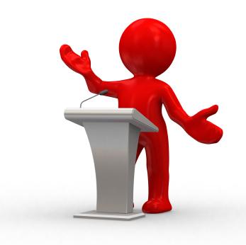 speaker behind a podium